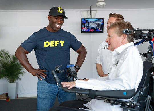 Former Denver Bronco and pro football Hall-of-famer Terrell Davis talks with IndyCar team owner Sam Schmidt at the Indianapolis Motor Speedway on Thursday, May 16, 2019. Davis and DEFY CBD-based performance drink have teamed up and are a sponsor Arrow Schmidt Peterson Motorsports.