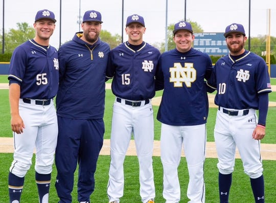 Notre Dame analytics director Luke Vandertie (second from right) with fellow seniors Jake Singer (10), Eric Gilgenbach (15) and Shane Combs (55) on recent Senior Day