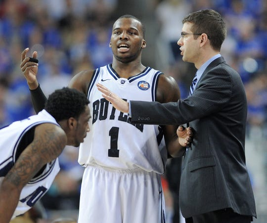 Butler's Shelvin Mack talks with coach Brad Stevens during the NCAA Men's Final Four at Reliant Stadium in Houston, Texas.