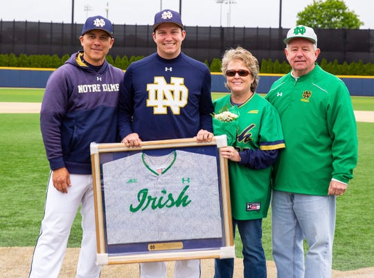 Luke Vandertie (center) on Senior Day with Notre Dame baseball coach Mike Aoki and parents Dave and Shelly Vandertie