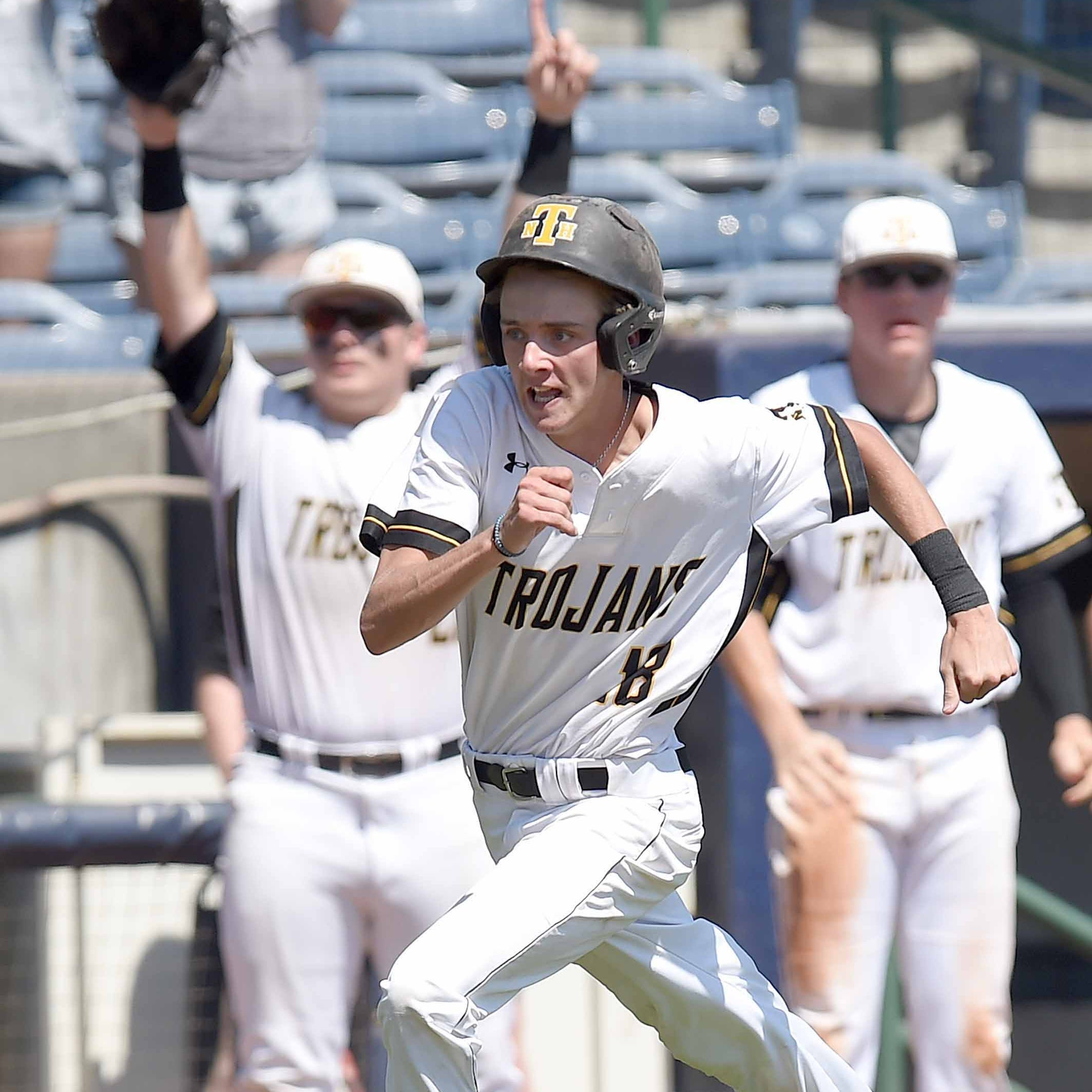 New Hope's Landon Sanderson (18) heads for home against Sumrall in the MHSAA State Baseball Championships on Thursday, May 16, 2019, at Trustmark Park in Pearl, Miss.