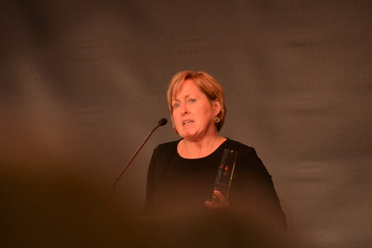 Red Cross Mid-West Tennessee Humanitarian of the Year Amy Crenshaw accepts her award at the 2019 Red Cross Heroes Luncheon.