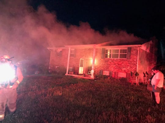 A family cat was killed and a juvenile was taken into custody following a house fire on Midhurst Drive in Farragut on Wednesday night, May 15, 2019.