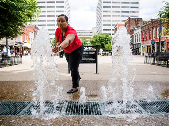 A water sample is collected from the Market Square splash pad in downtown Knoxville on Monday, May 13, 2019.