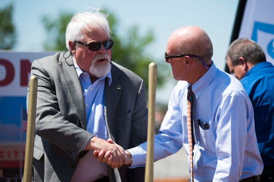 Blount County Mayor Ed Mitchell shakes hands with Food City President and CEO Steven Smith at the groundbreaking ceremony for the grocery store at 1715 W. Broadway in Maryville on Thursday, May 16, 2019.