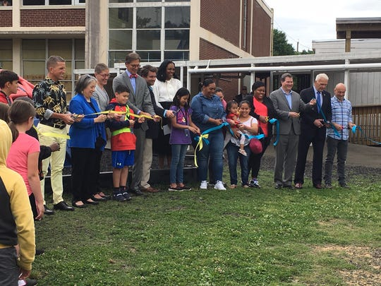 Great Schools Partnership President Stephanie Welch, Lonsdale Elementary Principal Christopher Deal, Mayor Madeline Rogero and others cut a ribbon on a new playground at Lonsdale Elementary last spring.