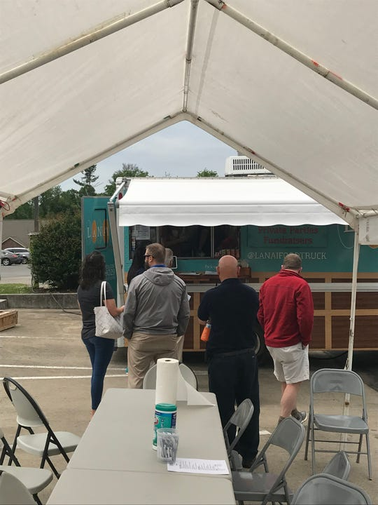 Diners line up at the Lanai Food Truck on May 15, 2019, at Jackson Oaks West Office Park.