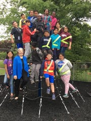 Mayor Madeline Rogero came to the ceremony ready for fun; here she joins the Lonsdale Elementary kids on their brand new net climber. May 15, 2019.