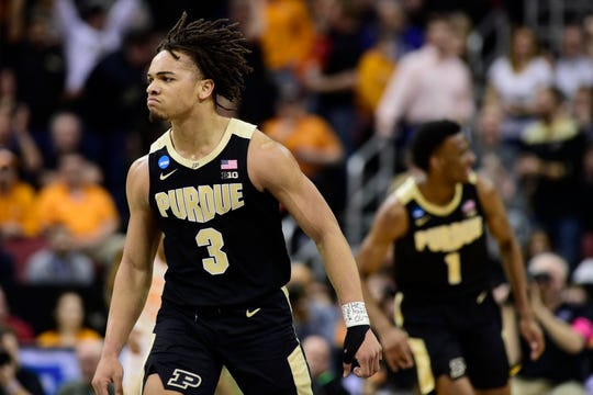 Purdue guard Carsen Edwards (3) reacts during the first half in the semifinals of the south regional against Tennessee in the 2019 NCAA Tournament at KFC Yum Center on March 28, 2019. Mandatory Credit: Thomas J. Russo-USA TODAY Sports