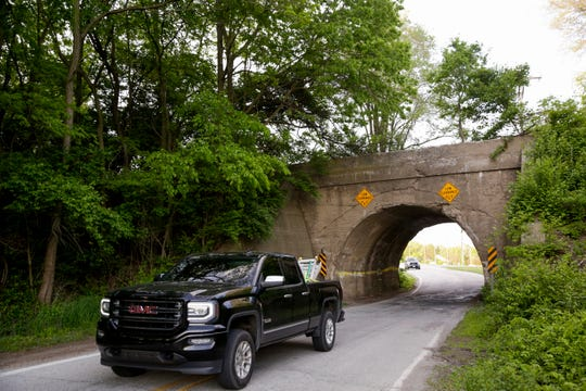 A truck crosses under the Newman road railroad bridge, Wednesday, May 15, 2019, in West Lafayette.