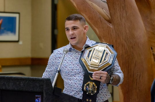 UFC lightweight champion Dustin Poirier speaks at a ceremony during which he was awarded a key to the city for his work with the Good Fight Foundation and his contributions to the community.