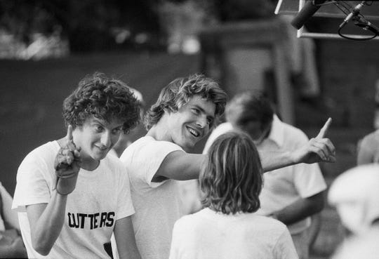 "Actors Daniel Stern, left, and Dennis Quaid, center, celebrate after winning the Little 500 bike race, during the filming of the movie ""Breaking Away."" Stern played the role of ""Cyril,"" and Quaid was ""Mike"" in the movie. Sept. 10, 1978."