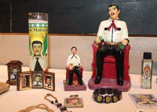 An assortment of images of Jesus Malverde