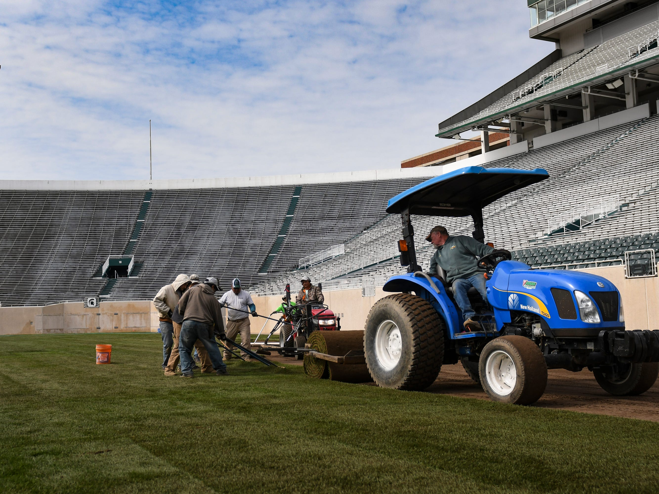A crew of workers installed new Kentucky bluegrass sod Wednesday on the football field at Michigan State's Spartan Stadium in East Lansing.  About 375 rolls of new Kentucky Bluegrass will cover the nearly 70,000 square feet on the stadium's playing surface.