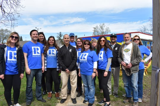 REALTORS from the community help launch the Creation of Hope on Lansing's south side.