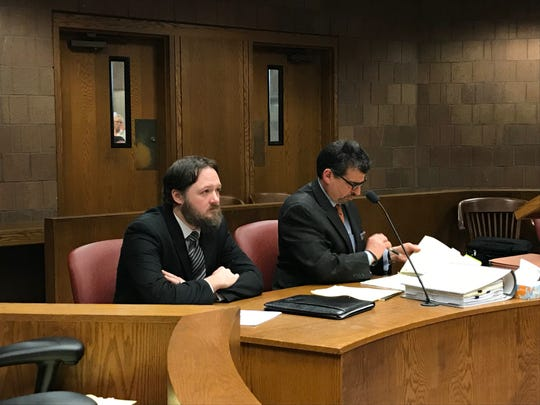 Patrick Daley, left, sits with his attorney,  Raymond Correll, on May 16, at his preliminary hearing for 10 counts of second-degree criminal sexual conduct.