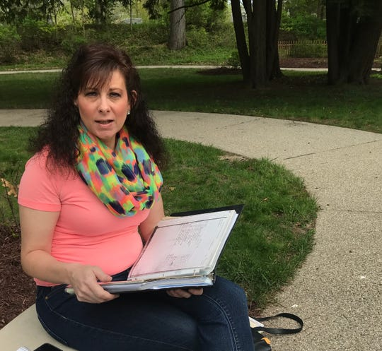 Michelle Pohl of Portland discusses her family history research May 15, 2019 that led her to an unmarked grave of a great uncle at the Mt. Hope Cemetery in Lansing. She has since placed a marker on the grave of Richard McKimmy, one of 61 boys who died at the Boys Training School in Lansing over several decades.