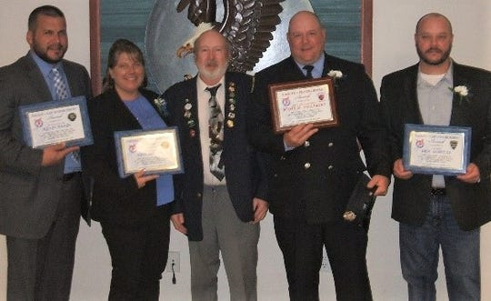 Manitowoc Eagles Aerie 706 recently honored local law enforcement and a firefighter. Pictured, from left: Manitowoc County sheriff's deputy Kevin Haese, Manitowoc County corrections officer Jodi Miller, Manitowoc Eagles Aerie President David Flinn, Manitowoc firefighter Scott Valleskey and Manitowoc police officer Eric Schultz.
