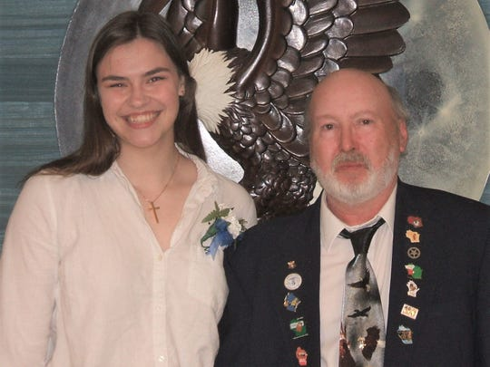 Manitowoc Eagles Aerie 706 President David Flinn (right) awards a college scholarship to Maria Laurent. Not pictured: Bryce Howe was also a recipient of a scholarship.