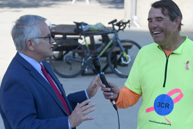 Bob Hood interviews Mayor Tim Theaker in the  courtyard at Mansfield City Hall on Thursday morning. Hood is the principle rider in the 3 Country Ride,  benefiting the Breast Cancer Research Foundation.