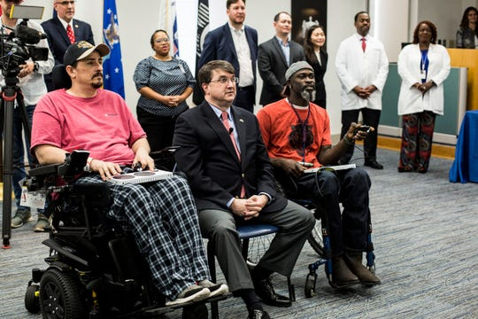 Department of Veterans Affairs Secretary Robert Wilkie, center, watches as United States Navy Veterans Michael Smith, left, and Anthony Gilliam, right, play a game using the Microsoft Xbox Adaptive Controller while visiting the Memphis VA Medical Center on Thursday, May 16, 2019.