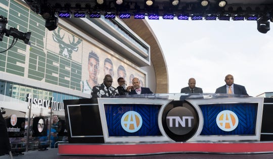 TNT NBA pre-game show hosts Shaquille O'Neal, left, Ernie Johnson Jr., Kenny Smith and Charles Barkley do their telecast before the Eastern Conference finals game Wednesday, May 15, 2019 outside  Fiserv Forum in Milwaukee, Wis.