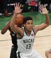 Toronto Raptors forward Kawhi Leonard (2) tries to pass the ball past Milwaukee Bucks guard Malcolm Brogdon (13) during the second half of their Eastern Conference finals game Wednesday, May 15, 2019 at Fiserv Forum in Milwaukee, Wis. The Milwaukee Bucks beat the Toronto Raptors 108-100.