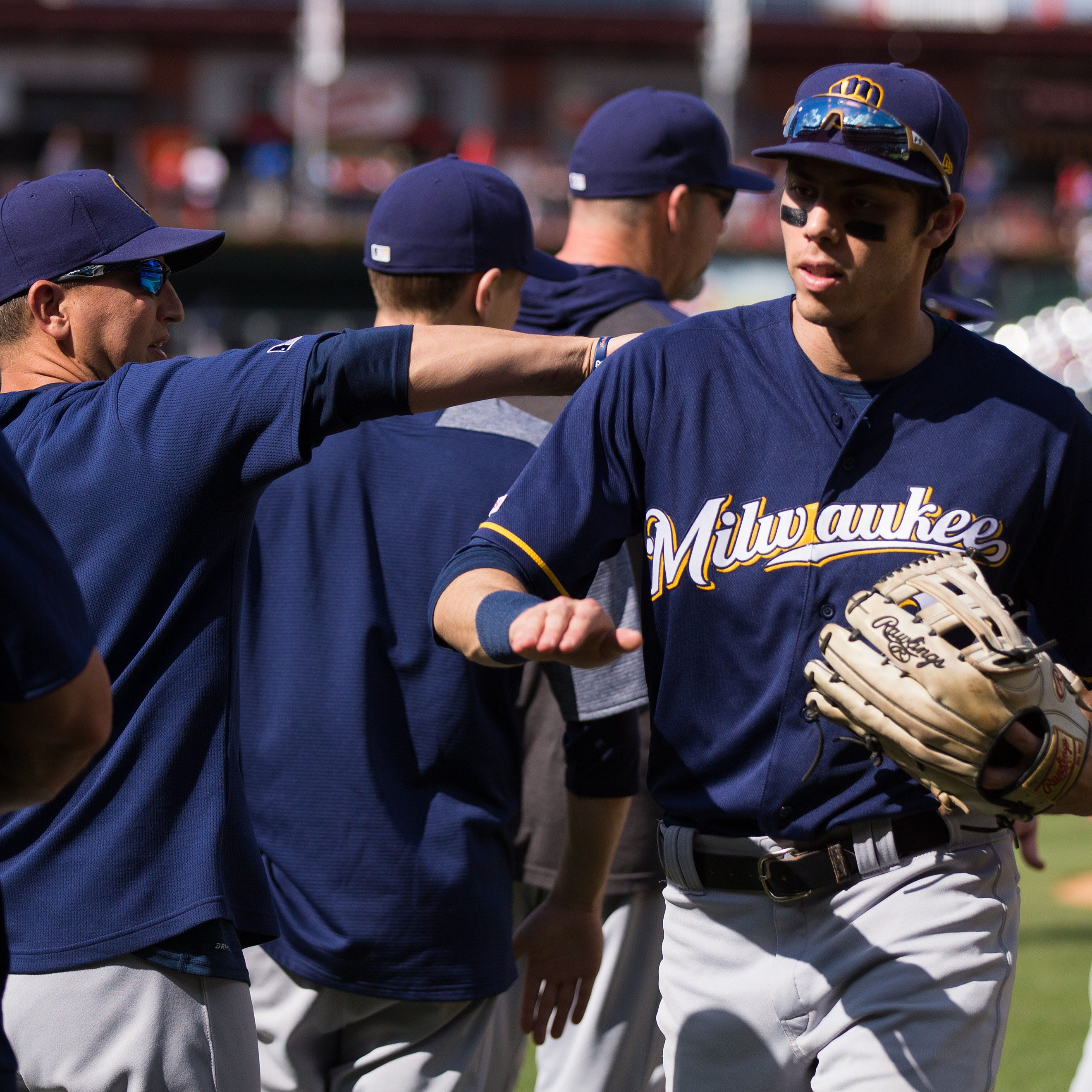 Christian Yelich has been scratched from starting lineup after experiencing back spasms