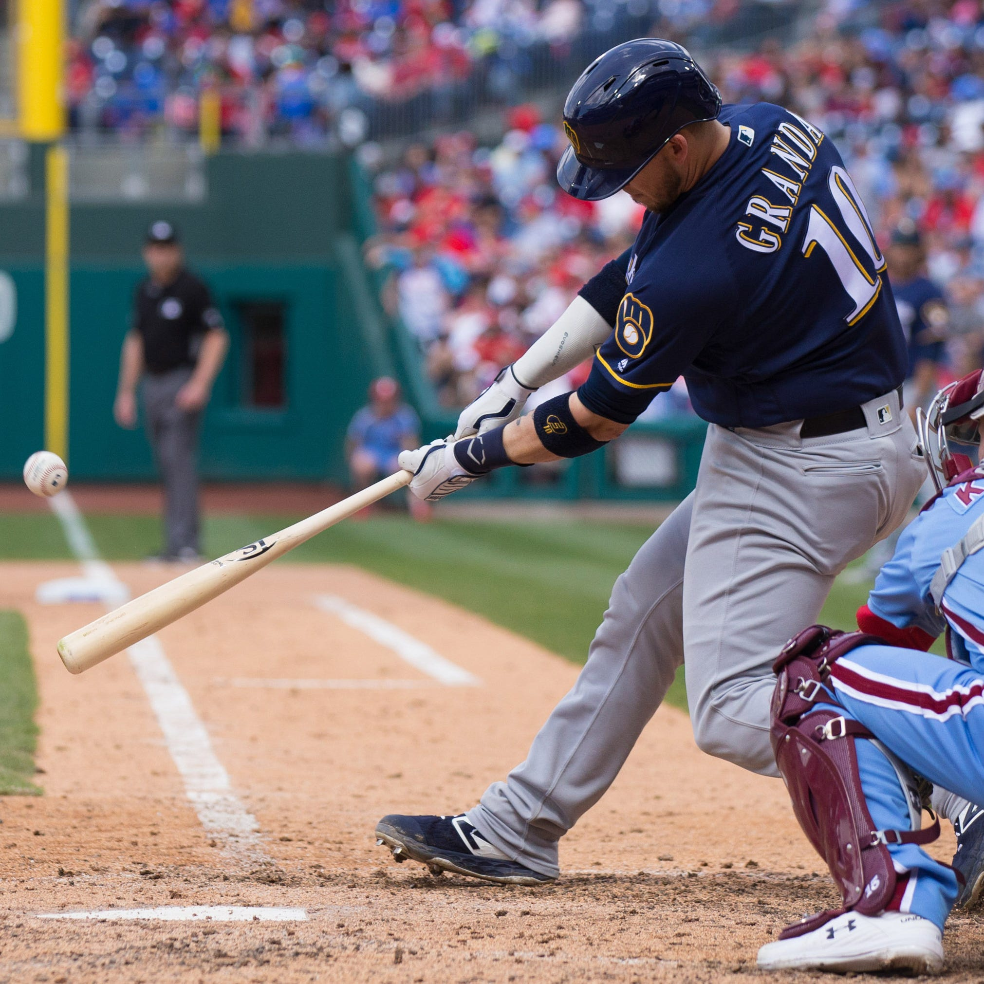 Following the lead of Christian Yelich, the Brewers' deep lineup kept coming at the Phillies