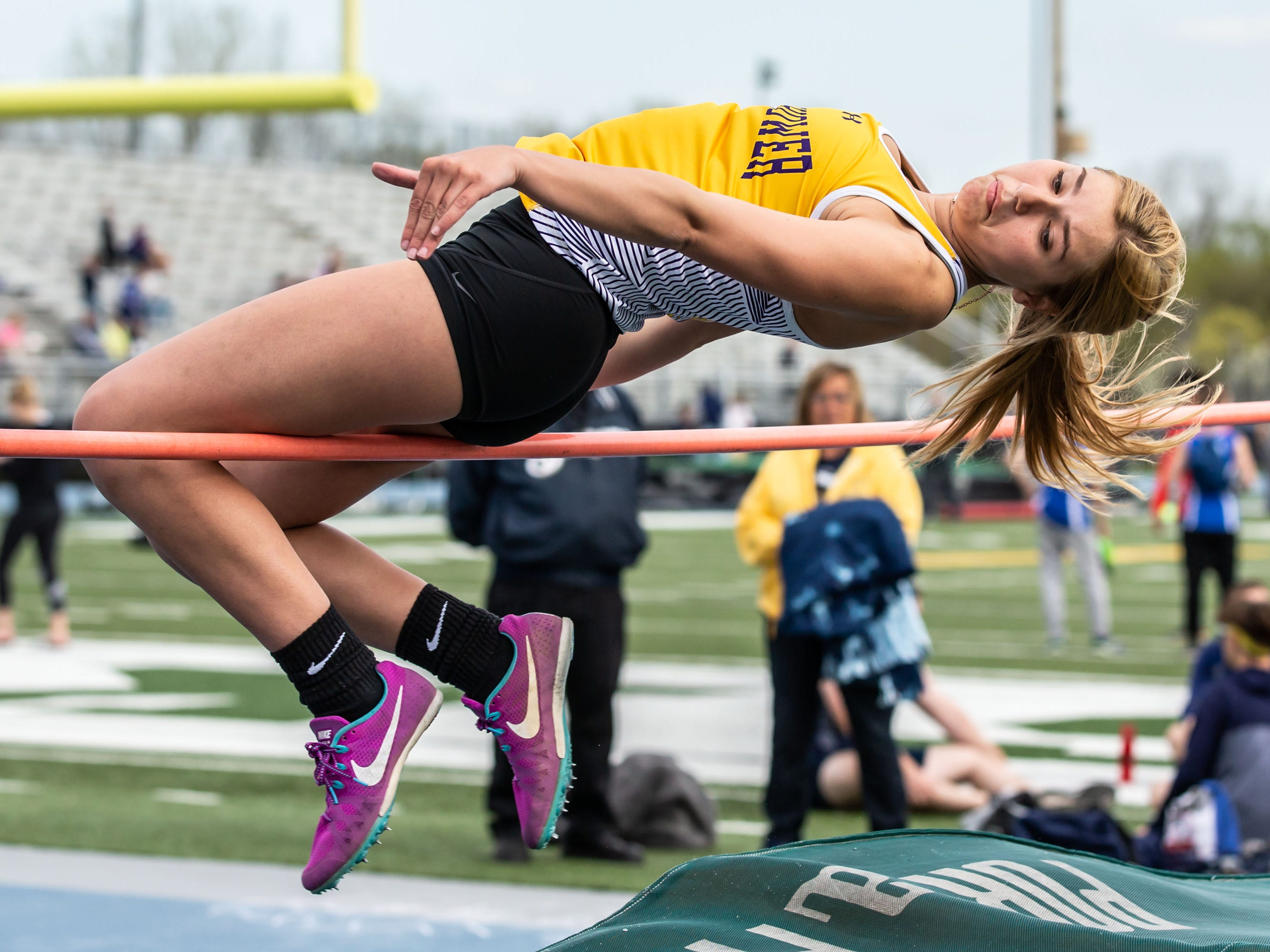 New Berlin Eisenhower's Kiara Mckowen competes in the high jump at the Woodland Conference Track and Field Championships in West Allis on Tuesday, May 14, 2019.