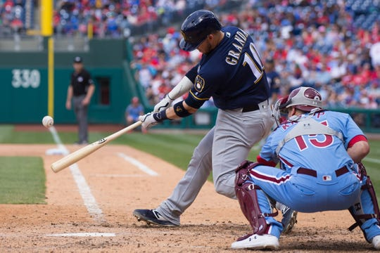 Brewers catcher Yasmani Grandal hits a three-run home run in Philadelphia.