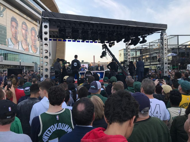 Fans prepare to watch the live broadcast of Inside the NBA outside Fiserv Forum on Wednesday before Game 1 of the Eastern Conference finals.
