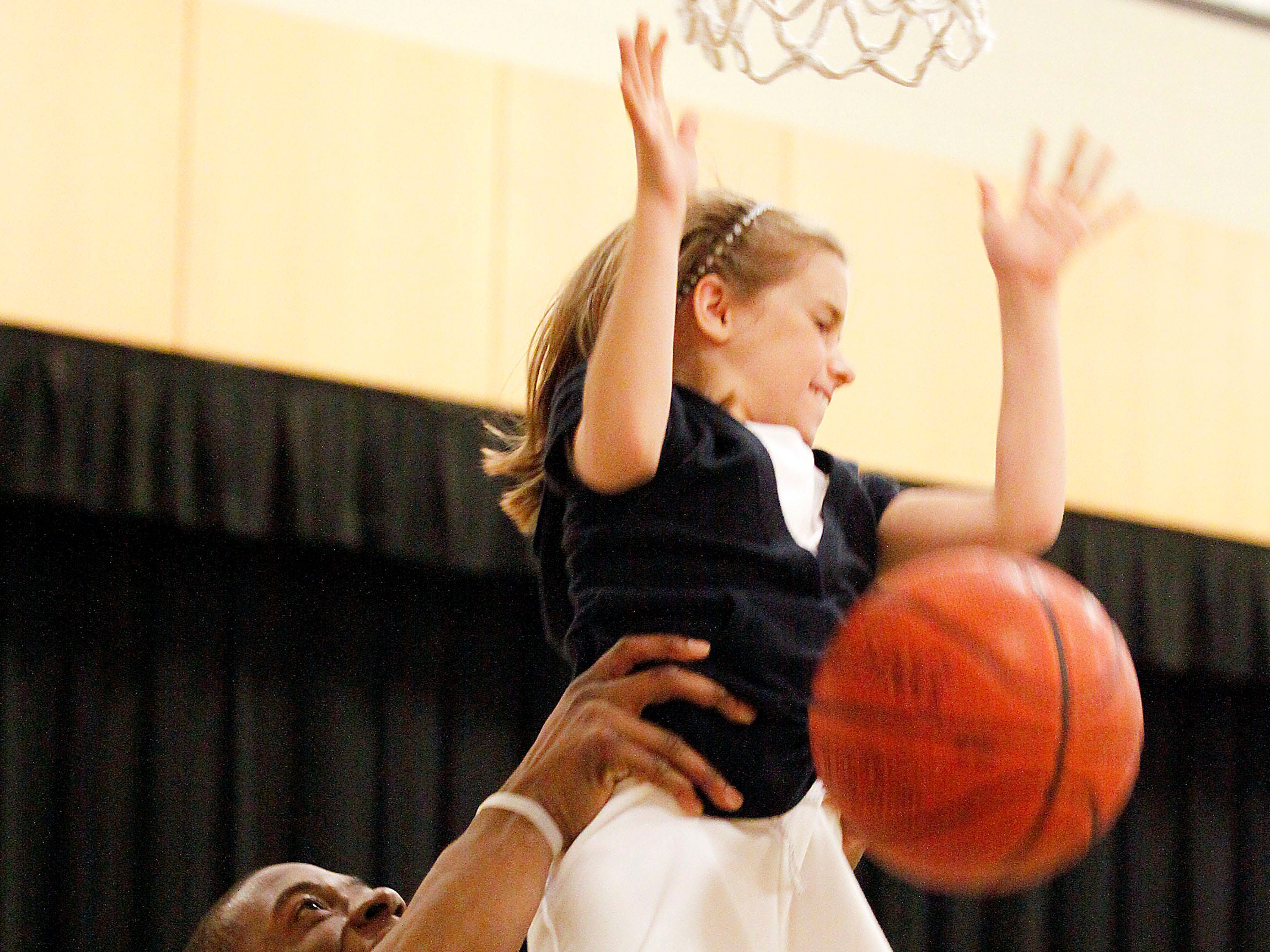 St. Jerome third-grader Anna Judkins an assist for her shot from Marquette's Dwight Burke on May 19, 2009. Burke and teammate Wes Matthews were at the Oconomowoc school for its athletic banquet.