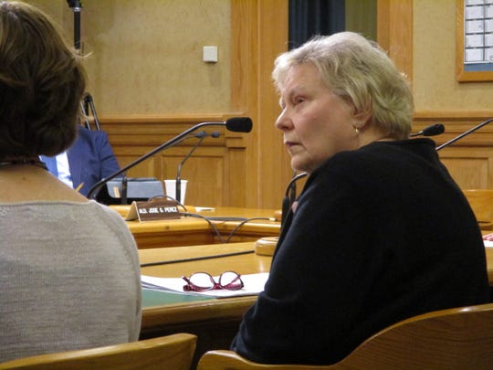Denise Bartlett listens to comments being made by members of the community on her appointment before the Public Health and Safety Committee meeting's vote.