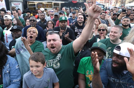 Fans cheers as TNT NBA pre-game show hosts Shaquille O'Neal, Ernie Johnson Jr., Kenny Smith and Charles Barkley do their telecast before the Eastern Conference finals game Wednesday, May 15, 2019, outside Fiserv Forum in Milwaukee.