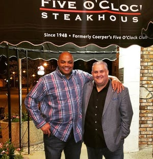 NBA star Charles Barkley (left) took a picture with Five O'Clock Steakhouse Managing Partner Stelio Kalkounos after his dinner on Tuesday, May 14.
