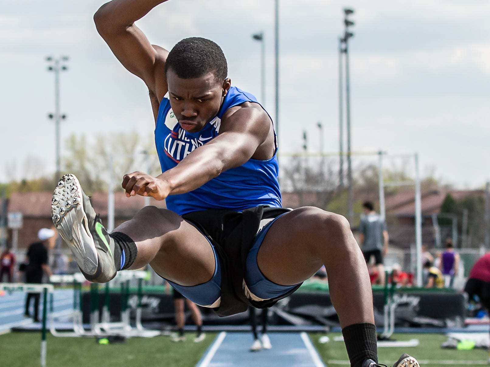 Wisconsin Lutheran's Jeremiah Hampton competes in the long jump at the Woodland Conference Track and Field Championships in West Allis on Tuesday, May 14, 2019.