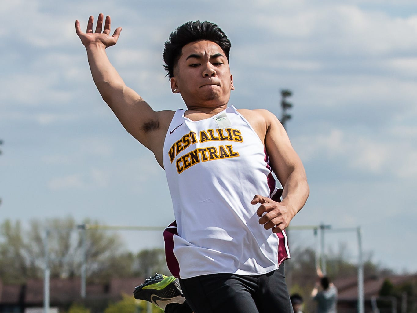 West Allis Central's Kevin Nguyen competes in the long jump at the Woodland Conference Track and Field Championships in West Allis on Tuesday, May 14, 2019.