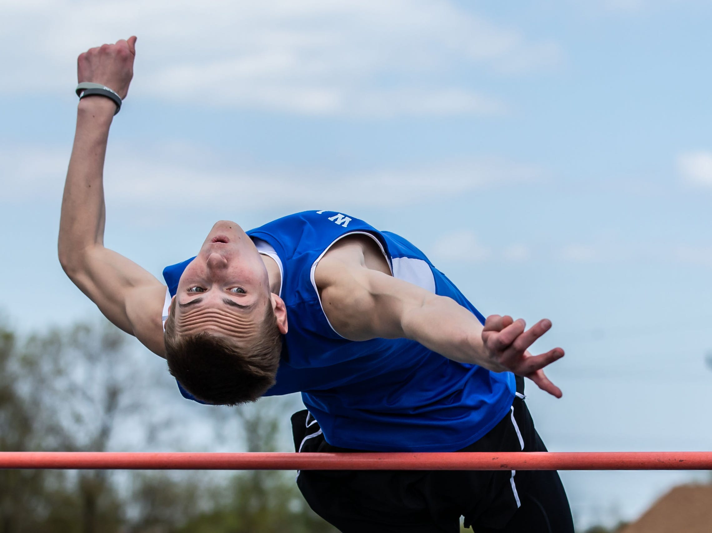 Wisconsin Lutheran's Nathan Miller competes in the high jump at the Woodland Conference Track and Field Championships in West Allis on Tuesday, May 14, 2019.