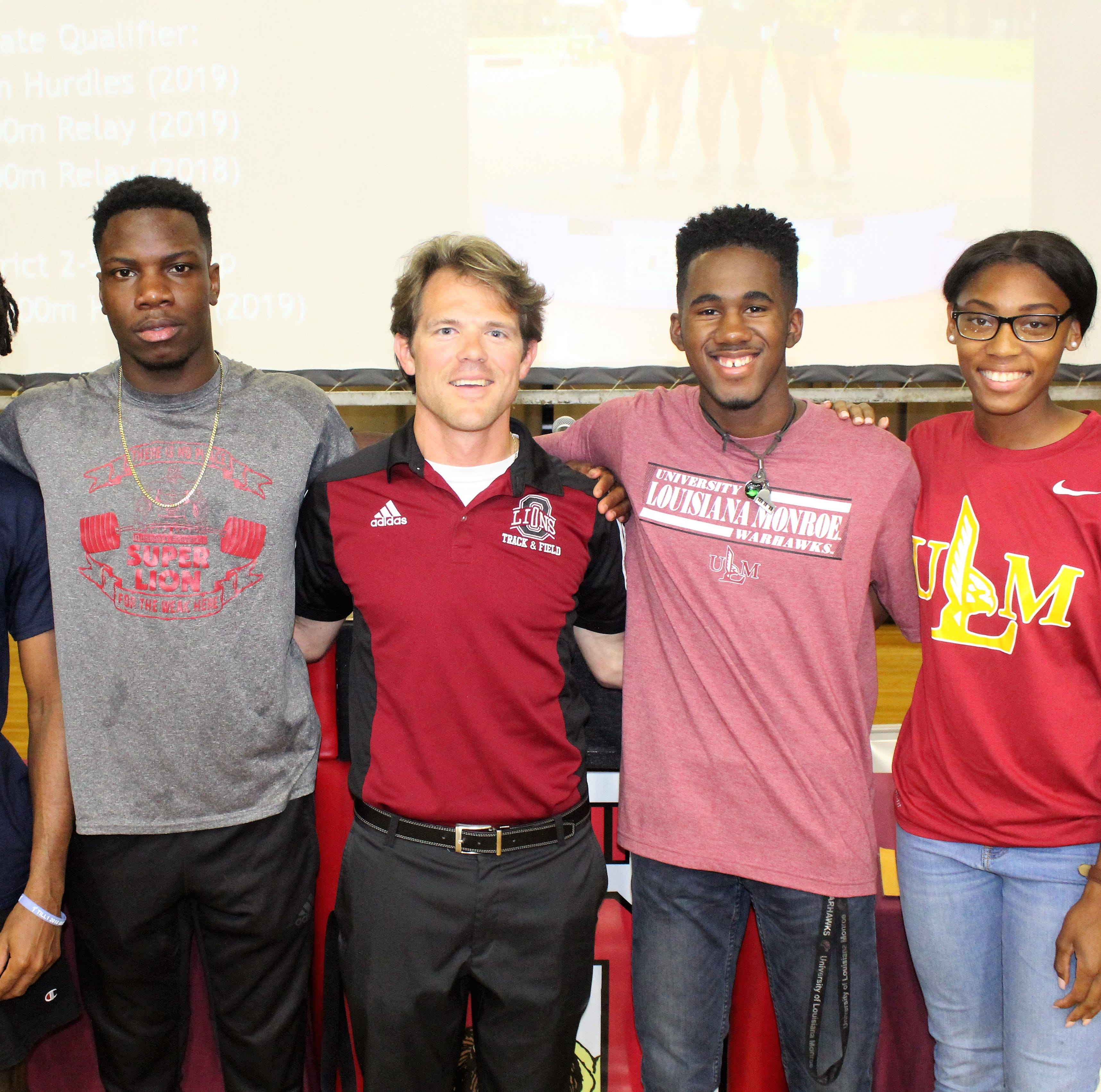 (left to right) Javier Johnson, Tony McNeal, Ouachita track and field coach Morgan Smith, Jaylen Wade and Di'Keriun Straughter celebrate during a signing ceremony on Thursday at Ouachita Parish High School