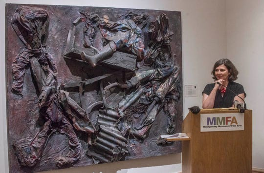 "Angie Dodson, director of the Montgomery Museum of Fine Arts, announces the acquisition of five new works by African American artists from Alabama, including this piece by Thornton Dial Sr. called ""Lost Americans,"" on Tuesday."