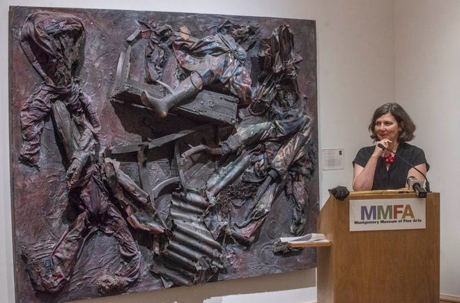 Angie Dodson, Montgomery Museum of Fine Art's new director, announces the acquisition of five new works by African-American artists from Alabama, including this piece by Thornton Dial Sr called Lost Americans, on Tuesday, May 14, 2019.