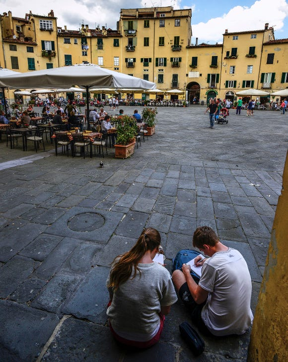 The Piazza dell'Anfiteatro in Lucca was once a Roman amphitheater.