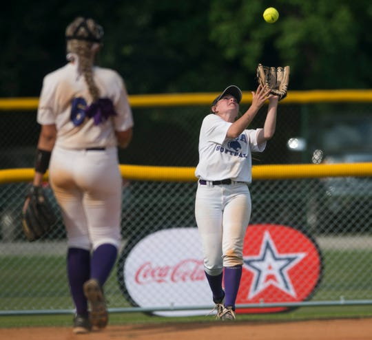 Prattville Christian's Madison Hanson (12) catches an outfield pop fly during the Class 3A state tournament at Lagoon Park in Montgomery, Ala., on Thursday, May 16, 2019.