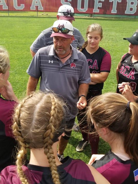 Alabama Christian softball coach Chris Goodman offers instruction.