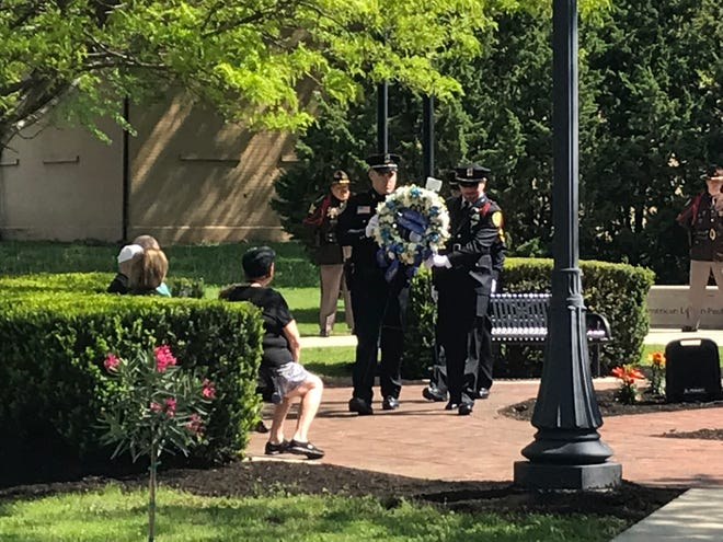 About 100 people – including representatives from several area police agencies – on Thursday attended a downtown Police Week ceremony honoring the four Muncie police officers who have died in the line of duty.