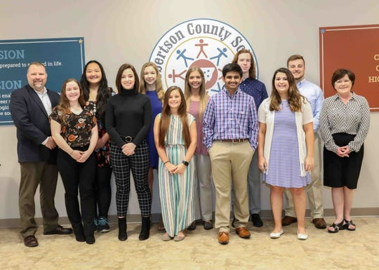 Director of Schools Dr. Chris Causey, and Assistant Director Ms. Stephanie Mason welcomed the valedictorians and salutatorians. Pictured between the administrators are the county's top students. Salutatorians on the front row and valedictorians on the back.