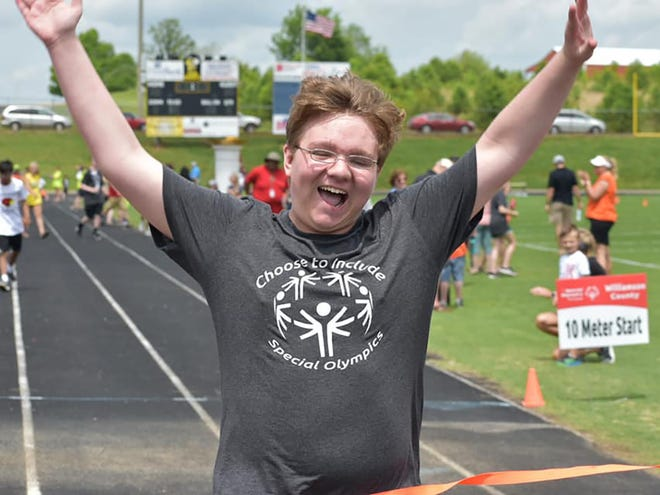 Youth celebrates 2019 Special Olympics win.