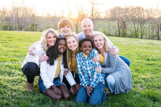 Jay and Candi Galbreath, who live in Brentwood, pictured with their five children.