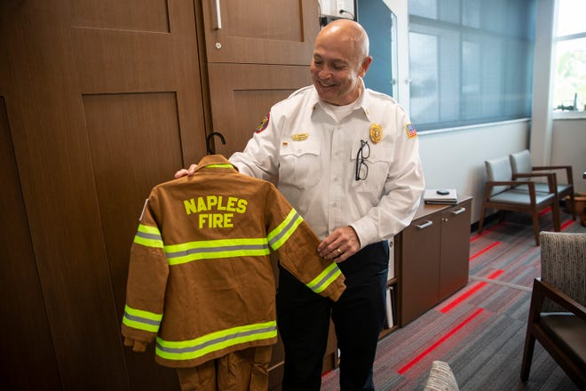 Naples Fire Chief Pete DiMaria talks about some of the actives children participate in, such as participating in firefighting exercise while wearing their own uniform, Thursday, May 16, 2019, during an interview at the new Naples Fire Department Station 1.